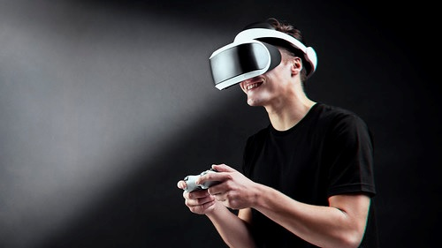 Playing game with VR headset virtual